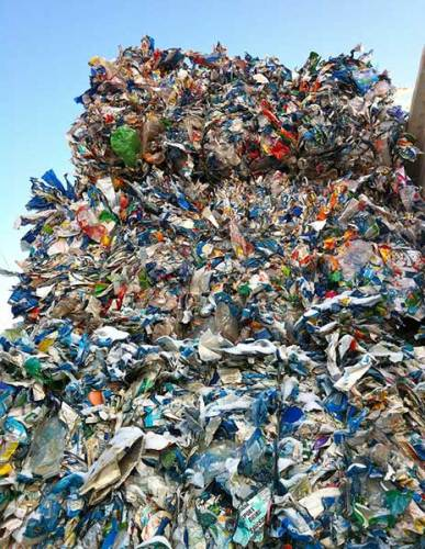 Huge pile of crushed plastic bottles